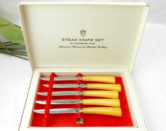 Mid century Vintage Washington Forge stainless steak knife set in original box butterscotch Bakelite steak knives made USA