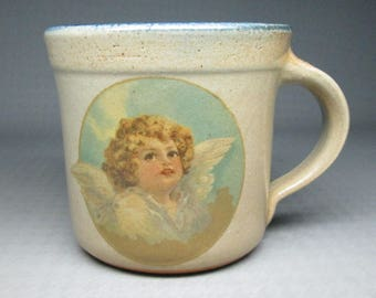 MONROE SALT WORKS mug with a cherub / angel