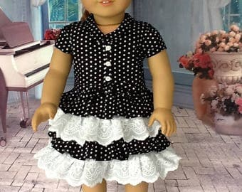 18 inch retro ruffled dress. Fits American Girl Dolls. Black dots with white eyelet trim.