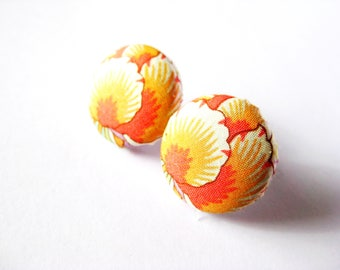 Fabric covered button earrings with a floral pattern in orange