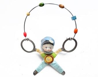 little JUGGLER (10), original art doll ornament, found object art, mixed media assemblage, by Elizabeth Rosen