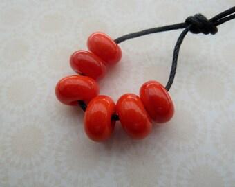 handmade lampwork orange / red glass beads, UK spacers