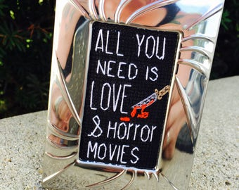 Mini Shiny Silver Framed Cross Stitch - All You Need Is Love & Horror Movies