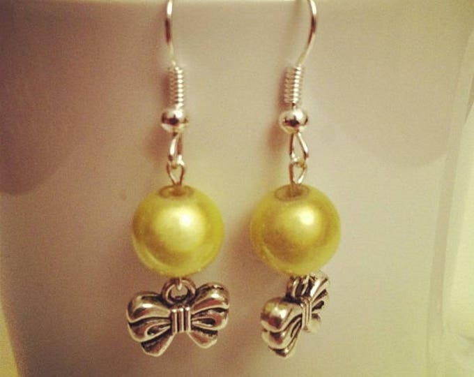 Bows and lime green bead earrings