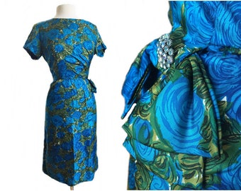 Vintage 1960s floral silk wiggle dress/ blue green cocktail dress/ rhinestone bow/ Nelson-Caine
