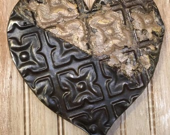 Ornate dark brown/black and cream heart designed with antique tin ceiling tile