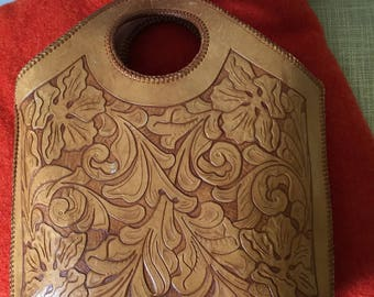 Hand tooled leather purse from the 1970's