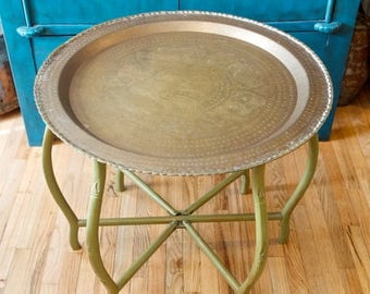 Vacay SALE...ships 7/8... SALE...Vintage brass top table with folding wooden base...etched brass tray table…good fortune…feng shui.