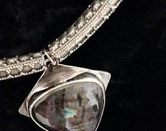 Archer. Arrowhead influenced pendant,  sterling silver, labradorite spectrolite pear gemstone.