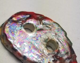 Iridescent button