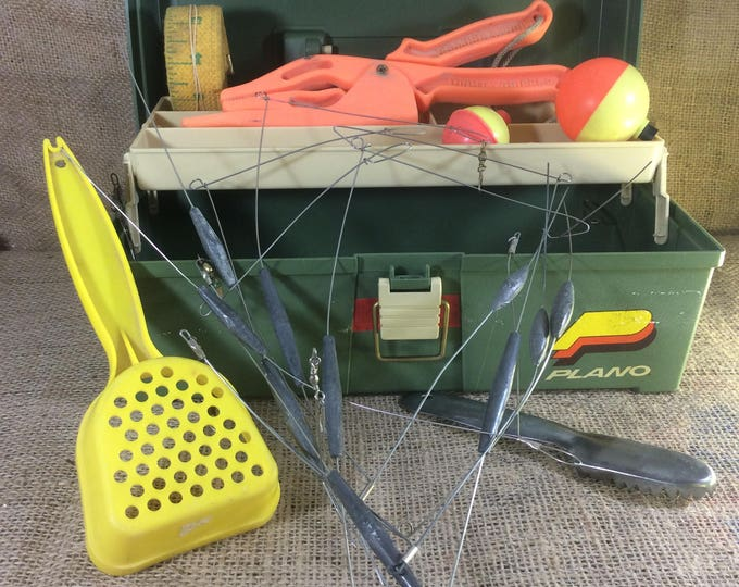 Vintage Plano tackle box, vintage tackle, plastic vintage Plano tackle box, green Plano tackle box with some gear, cool retro artist box