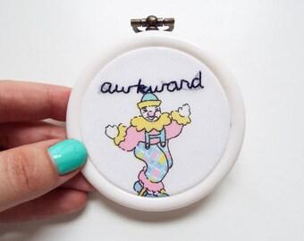 Hand embroidered mini hoop art - text on vintage fabric - awkward