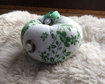 Hand stitched green and white pin cushion