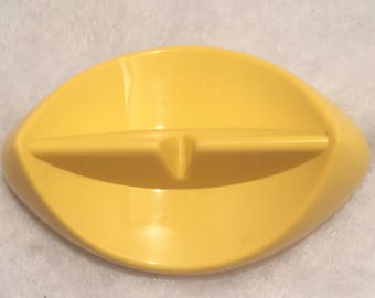 Tupperware yellow knife rest