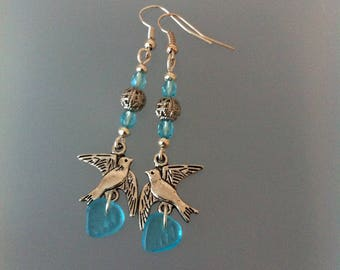 Earrings blue and silver colors with birds
