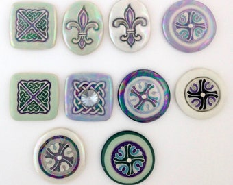 Hand painted embossed design porcelain cabochons. Celtic knot, Fleur de lis, Japanese carnation designs in green, blue, black and white.
