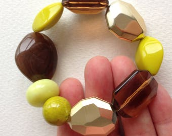 Bracelet -  in sage green and lime green marbled and transparent plastic pebble shaped  and silver faceted bead bracelet retro design