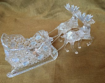 Vintage plastic pair of riendeer and sleigh with iridescent glitter