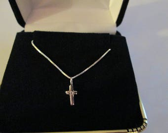 "Mini Sterling Silver Cross with White CZ and 18 "" Sterling Chain."