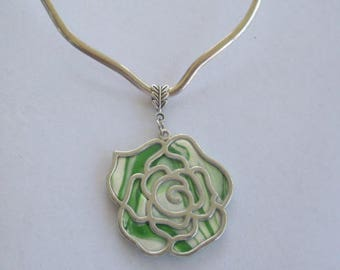 waved silver neck wire with shades of green and white rose pendant