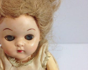 Old Doll in Old Dress Parts Sleepy Eyes