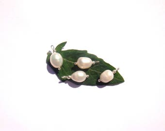 Fresh water pearls: 4 microphone charms 15 mm long x 8 mm in diameter