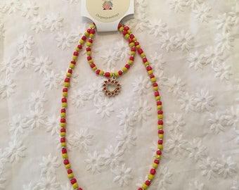 Girls yellow and orange beaded necklace and bracelet set