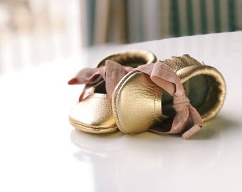 Gold 100% leather baby moccasin mary jane style with tie