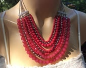 Nine strands of gorgeous red tones beads and silvertone chain bib necklace.   Lovely retro style classic perfect for any occasion or outfit.