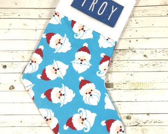 Personalised christmas stocking with embroidered name, blue santa design, handmade