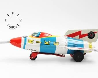 Vintage NIKE Friction Powered Space Rocket Toy SR-7 / MS Masuya Japan Missile Rakete / Ship Air Plane Tin Toy Metal / made in Japan 60s 70s