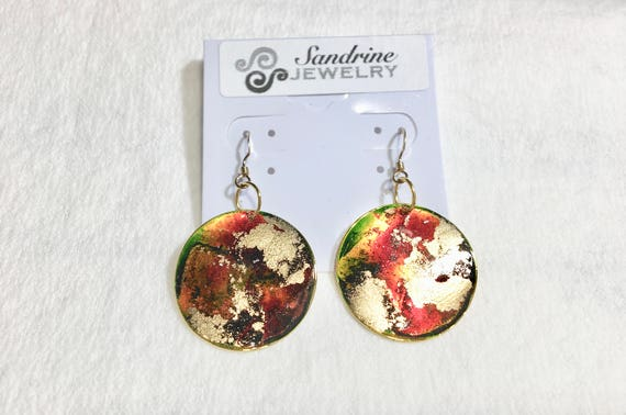Handmade round orange green gold enamel gold plated earrings with abstract designs