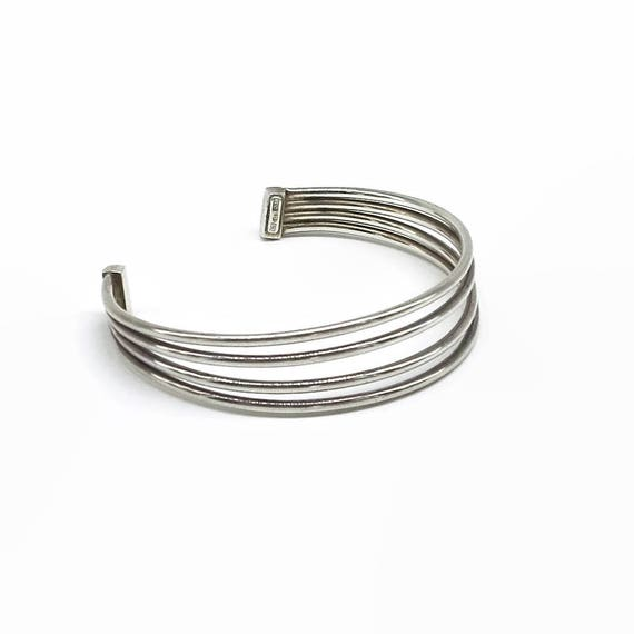 Sterling silver cuff bracelet with 4 bands, open back, adjustable size, made in Italy, 10 grams, circa 1980s