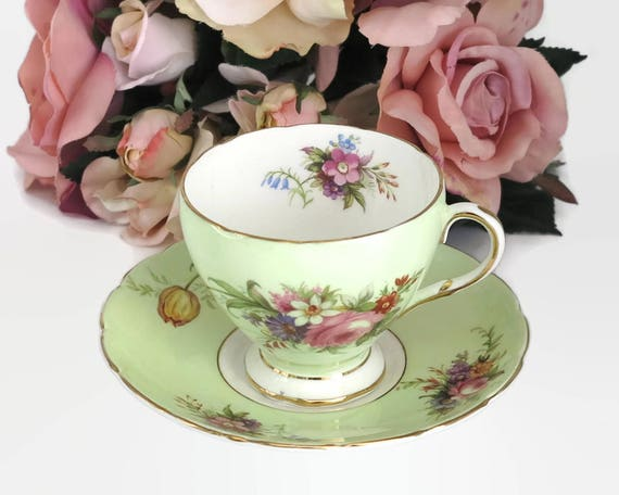 Vintage Foley cup and saucer, E Brain & Co, England, green background with tulips and roses, mid 20th century