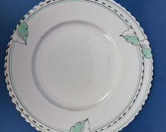 Two striking Art Deco hand painted plates. Green and black stylised leaves with banding and black dotted line edging