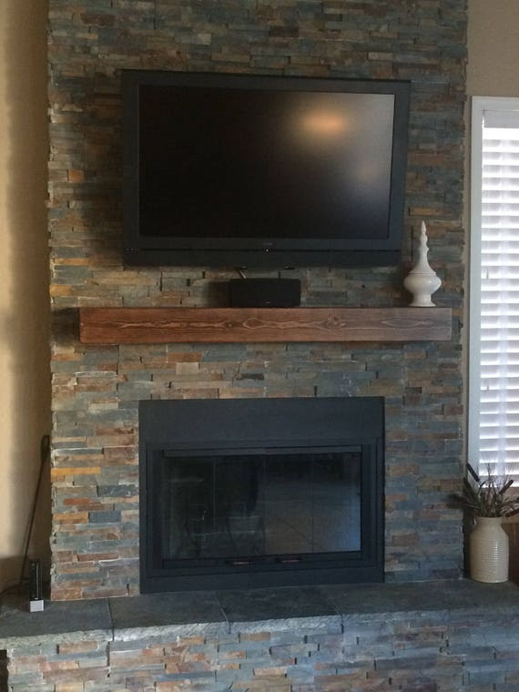 Rustic Wall Shelf  Custom hollow fireplace mantle . Look of a solid beam. Made out of wood