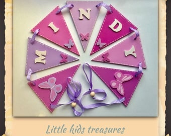 Girls Wooden butterfly bunting. Handmade and personalised. Pinks / lilacs. Price per section. Little kids treasures