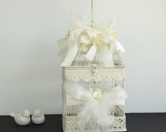 Cage decoration with flowers and ribbons wedding urn