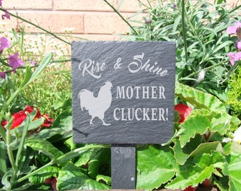 A Natural Slate Plant Marker etched with the message 'Rise & shine mother clucker!'  (SR1684)