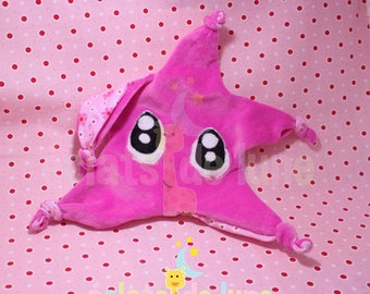 Flat plush star with large pink eyes