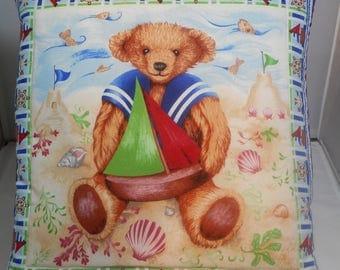cushion bear decoration at the seaside by a world ' bear