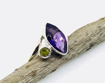 10% Amethyst, peridot ring set in sterling silver 925. Natural authentic stones. Size-6. Satisfaction guaranteed .