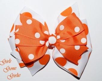 Orange and white hair bow , Halloween bow , double pinwheel bow , polka dot bow , baby Halloween hairbow , toddler Halloween bow , 4 1/2 in