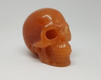 Red adventurine crystal skull.