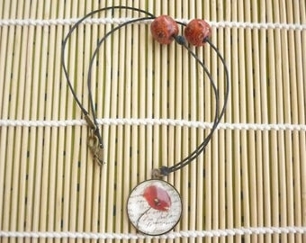 """Round pendant in bronze with a theme """"Poppies""""."""