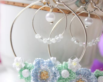 Hoop earrings with crystals and flowers