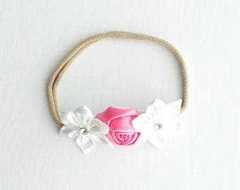 Pink rose and white flowers on a nylon headband