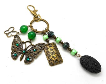 A scent! bag jewel bronze butterflies and beads in shades of green charms and co.