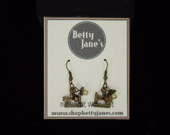 Antique Bronze Sewing Machine Earnings