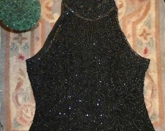 Gorgeous vintage black embellished sequin top. 100 percent silk. Best fit UK size 6/8